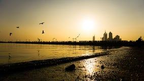 Crépuscule par le bord de la mer Photo libre de droits