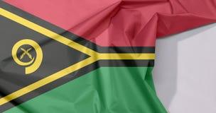 Crêpe et pli de drapeau de tissu du Vanuatu avec l'espace blanc images libres de droits