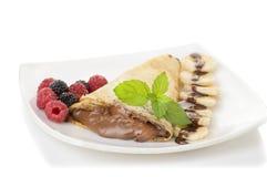 Crêpes avec de la crème et la banane de chocolat Image stock