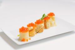Crêpes avec le caviar et le fromage saumonés Images libres de droits