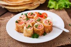 Crêpes avec le fromage saumoné et fondu Photographie stock libre de droits