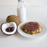 Crêpes de noix de coco de cerise Photographie stock