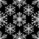Simple seamless pattern with snowflakes on black background stock illustration