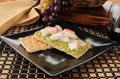 Crab And Guacamole On Crackers Stock Images