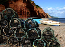 Crab baskets at Sidmouth beach. A pile of crab baskets fronts the view of the beach and triassic era mudstone cliffs at Sidmouth, Devon, England Stock Photo