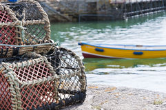 Crab Cages. Detail of crab cages with small vessel in the background Stock Images