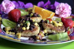 Crab Cake Dinner. Crab cakes with a delightful Tropical fruit salsa stock photography