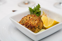 Crab Cake and Lemon Wedge Royalty Free Stock Images