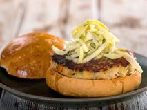 Crab cake sandwich with coleslaw garnish Stock Photography