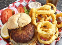 Crab Cake Sandwich with Onion Rings Royalty Free Stock Image