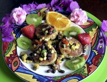 Crab Cakes. With Tropical fruit salsa stock photo