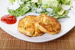 Crab Cakes and Cocktail Sauce with Caesar Salad Stock Photos