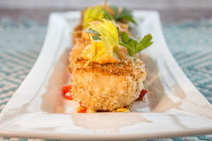 Crab cakes with corn relish Stock Photo