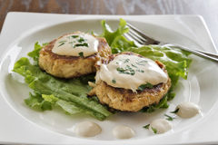 Crab cakes with creamy mustard sauce Stock Image