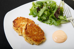 Crab Cakes and Salad from Above Stock Photo