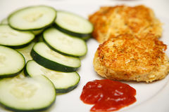 Crab Cakes with Sliced Cucumbers and Cocktail Sauce Royalty Free Stock Photo