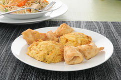 Crab cakes and Thai chicken salad Royalty Free Stock Image