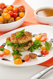Crab Cakes and Tomato Salad Royalty Free Stock Photos