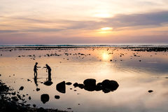 Crab catchers and the colorful beautiful sunset in Phuket. Thail. And. Nai Yang beach Stock Photo