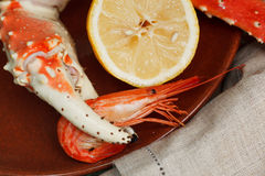 Crab claw grasping a shrimp Royalty Free Stock Photography