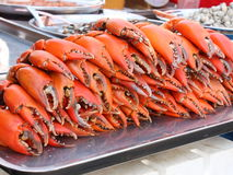 Crab claws at a fish market stall in Chinatown, Bangkok. Crab pincers (claws) for sale at a fish market stall in Bangkok (Thailand Stock Photo