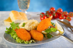 Crab claws with salad Royalty Free Stock Photos