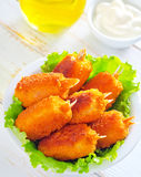 Crab claws. With white sauce stock image