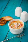 Crab cocotte with toast , salt and pepper on the cyan wooden table vertical Royalty Free Stock Image