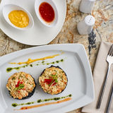 Crab cutlets served with sauces Royalty Free Stock Images