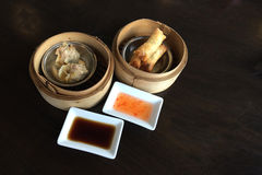 Crab dumplings and fried spring rolls. Stock Image