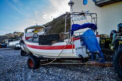 Traditional crab fishing boat moored up on the shingle beach in the seaside town of Cromer, Norfolk