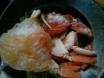 Crab with glass noodles. Street food in the market Royalty Free Stock Photos