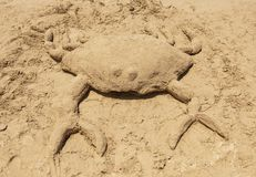 Crab made of sand royalty free stock photography