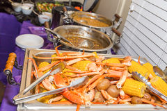 Crab Leg and Shrimp Boil Tray with Trimmings Royalty Free Stock Photos