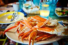 Crab legs with butter. Delicious meal in Florida, Key West or Miami stock photos