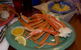 Crab legs diner meal. Snow crab legs butter and lemon diner meal Stock Photography