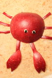 The crab. Made from an apple. A food for children on the breadcrumbs Royalty Free Stock Photo