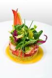 Crab meat appetizer, seafood delicacy in restaurant. Exclusive restaurant food, haute cuisine. Crab meat appetizer closeup on white plate. Seafood delicacy stock photos