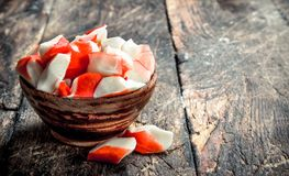 Crab meat in a bowl. On a wooden background royalty free stock photo