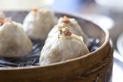 Crab meat buns. Chinese food, steamed bun in bamboo steamer royalty free stock images