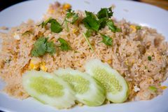 Crab meat fried rice, Khao Pad Poo. Thai famous street food. Thai recommend menu for tourist. Fried rice with crab meat and egg, cucumber on side dish royalty free stock photos