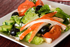 Crab meat Salad. With olives, lettuce, tomato Royalty Free Stock Photos