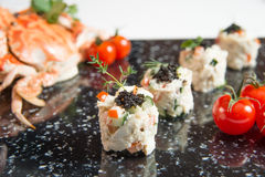 Crab Meat Salad with Black Caviar Horizontal tomato and crabs Royalty Free Stock Images