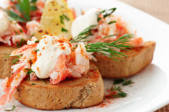 Crab meat with toast, sauce and fresh herbs Royalty Free Stock Photos