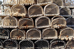 Crab Pots. Lined up on the harbor wall stock photo