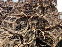 Crab Pots, Howth Ireland. Crab pots piled up at the fishing harbor of Howth, Ireland. Fishermen stack the woven rope pots on the dock to allow them to dry out Stock Photos