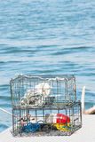 Crab Pots. Two crab pots stocked on a dock with blue ocean background. Vertical. Copy space stock photography