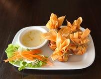 Crab rangoon with sauce Royalty Free Stock Photography
