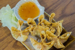 Crab rangoon. On the wood background Stock Image
