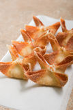 Crab Rangoons on white paper Stock Photography